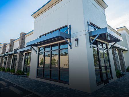 Installed Metal Sunshade Custom Product by Valentines Glass & Metal (VGM) at New Construction Project